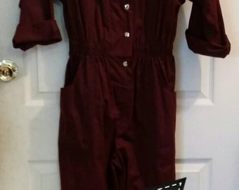 Vintage jumpsuit , new, still has the tag on it, circa 1980 s deep plum snap front,  built-in elastic waistband, jumpsuit