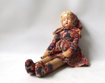 vintage 1930's composition head cloth baby doll poland polish old antique collectible decorative home decor blonde flowered dress red blue