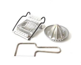 vintage 1950's aluminum collection of kitchen utensils tool cheese cutter boiled egg slicer hand held citrus orange juicer reamer housewares