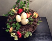 """LARGE 7"""" Spring Birds nest with faux greens, flowers and Eggs"""