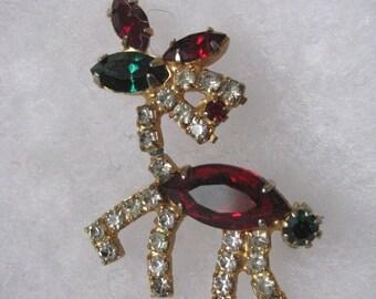 Vintage red green clear rhinestone holiday Christmas reindeer brooch pin