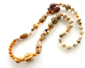 Vintage 1980s Artisan Mixed Media Necklace  36 Inch Rope, Amber, Wood, Stone, Apple Coral and Indian Brass Beads