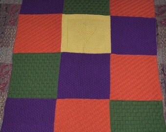 Hand knit blanket or afghan in a multicolored soft Acrylic