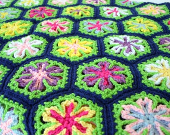 Crochet tropical flower afghan couch throw blanket bedding scrap yarn hexagons granny square blue green pink yellow white spring floral