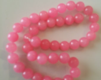 full strand of bubble gum pink 10mm beads