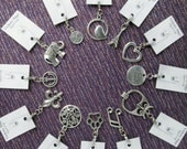 Playful embellishment tool for seamstress in whimsical designs - clip on zipper pull charms are easy sewing notions for bags & purses