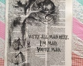 Cheshire Cat old dictionary print. were all mad here. Alice in Wonderland. Cheshire Cat. Old dictionary.