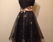 Fabulous 1980s does 1950s metallic gold and black strapless cocktail party dress with full net skirts  and lettuce edge hem by David Butler