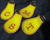 Keychain made from a softball, embroidered with your initial and laced to match