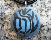 Hebrew  Modern - Shalom - Peace Dove hand carved on a polymer clay blue/grey pearl color background. Pendant comes with a FREE 3mm necklace