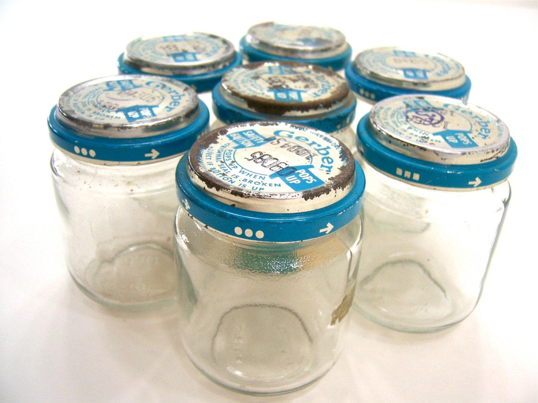 7 baby food jars glass with gerber blue and sliver lids. Black Bedroom Furniture Sets. Home Design Ideas