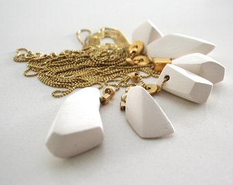 The white ceramic necklace collection with a touch of gold - modern geometric faceted necklace