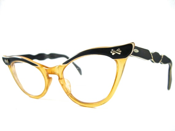 ornate cat eye glasses. plastic black and white frame by ...