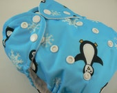 SALE - One Size Cloth Diaper - Blue Penguins Pocket Diaper with Welt opening on White Microfleece