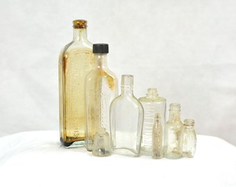 Antique Medicine Bottles Collection Set of 7 Dr. W. B. Caldwell Syrup Rawleigh's Corked Vintage Glass Apothecary Pharmaceutical