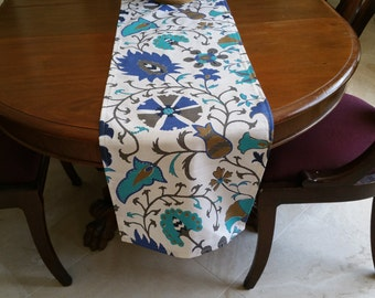 table runner in turquoise, marine blue and brown ikat pattern