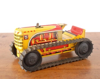 Vintage Marx Sparkling Climbing Tractor, 1950s yellow and red wind-up tin litho farm toy, tinplated steel, construction toys for boys