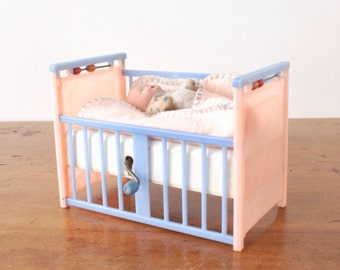 Vintage Mattel Creations Lullaby Doll Crib with original baby doll and blanket, wind up, A Futurland Music Box Toy, pink, baby blue plastic