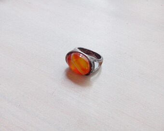 Vintage silver tone simple mod ring with orange glass stone.