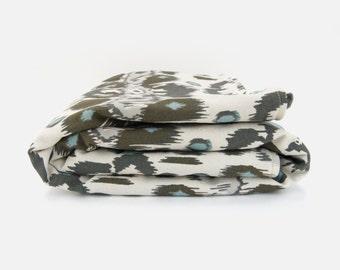 Modern baby blanket | Neutral gender nursery decor | Ikat floral in dusk blue, grey and ecru | Toddler and children throw blanket