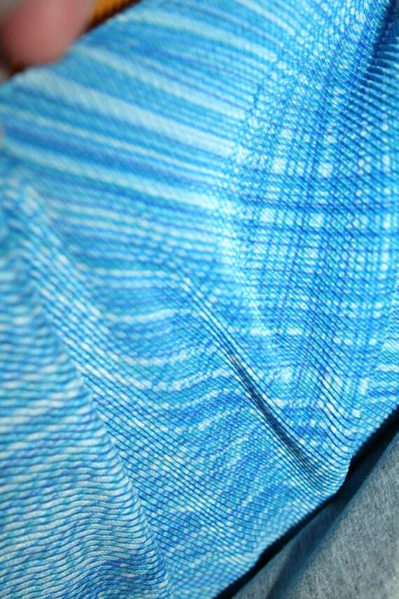 Blue Swirl Polyester/Lycra Slinky Print Knit (By the Yard)