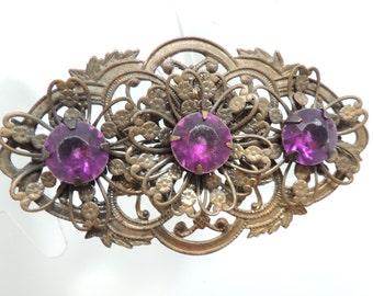 Semi Vintage Filigree Brooch with Purple Gems