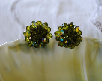 a pair of vintage clip on green jeweled earrings