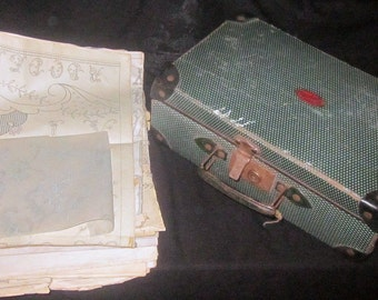 French vintage case with embroidery sheets inside.