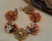 Vintage cluster beaded earring bracelet  orange cream pearl silver