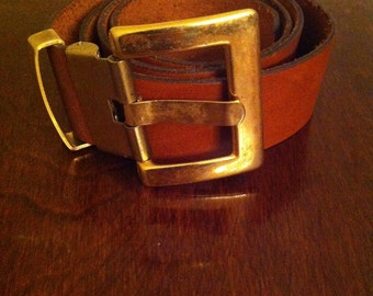 Vintage wide caramel leather belt with brass buckle.