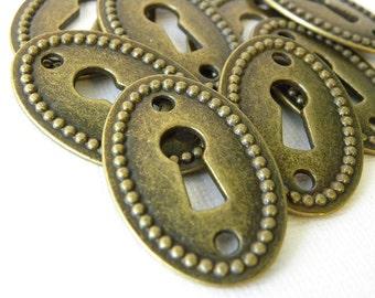 Bronze keyhole charm