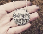 """Unique hand drawn metal etched mountains pendant necklave hand stamped with """"the mountains are calling and i must go"""" quote"""