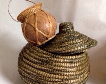 A Pair of Fascinating Round Baskets. One Coiled and Lidded. One Made of Gourd With Woven Straw Trim. One Large. One Small.