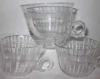 3 Crystal paneled Punch cup with cut etch with curly Q handle