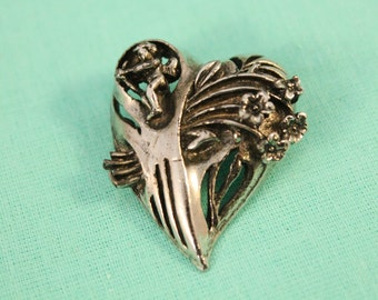 Interesting Silver Heart With Cupid And Flowers Brooch / Pin