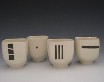 Set of four suared teacups