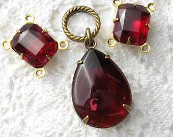 Three Piece Set of Ruby Red Glass Jewels in Antiqued Brass