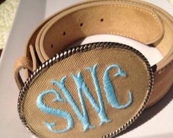Kristin Henchel custom women's monogram belt buckle - fish tale monogram. Tan fabric with light blue thread