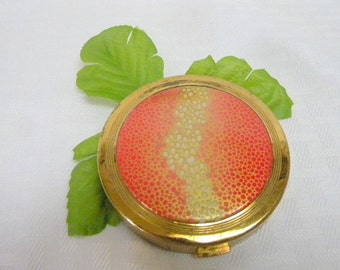 Coty Looseprest powder compact with midcentury hotpink enamel design on lid