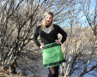 Green crinkle a-line mini skirt.