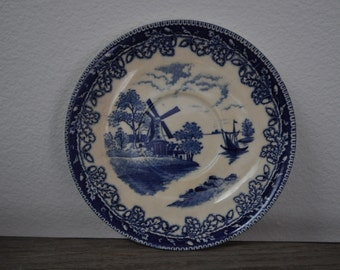 Small vintage blue and white windmill plate