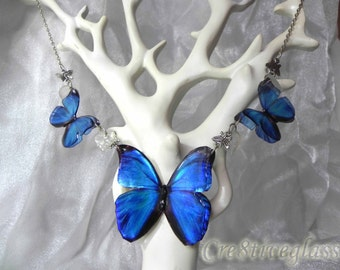 Blue Morpho butterfly resin necklace with crystal leaves