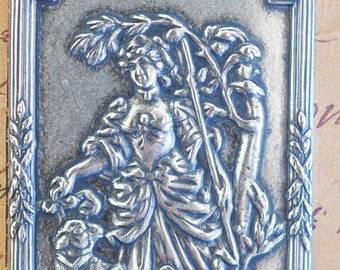 Ornate brass plaque with Marie Antoinette, Sterling Silver Finish