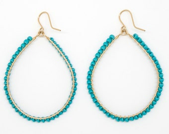 E2050 - large turquoise wrapped hoop earring