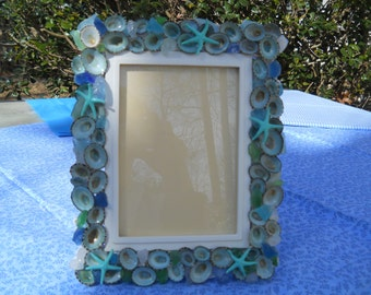 WHITE DECORATIVE BEACH frame with aqua limpets, seaglass and starfish from the seashore wedding frame