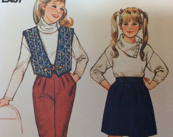 Butterick 6042 size 8 girls outfit sewing pattern, high waisted skirt pattern, pants pattern, vest pattern and turtleneck top pattern skivvy