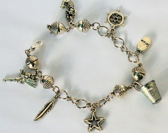 Peter Pan Acorn and Thimble Lost Boys and Peter Pan and Wendy Charm Bracelet II in Silver 7 Hidden Kisses