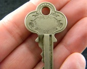 P & F Corbin ornate key fancy numbered
