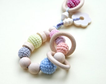 Big ring teething toy with wooden flower and wooden rings. Eco friendly rattle. Teether in pastel colors