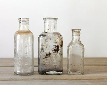 Vintage apothechary bottle set / clear glass / primitive cottage decor / shabby glass / rustic home decor / for altered art / patina / wear